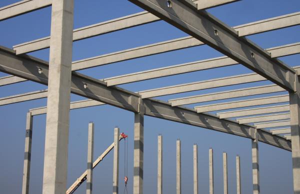 A building framework being assembled by a crane