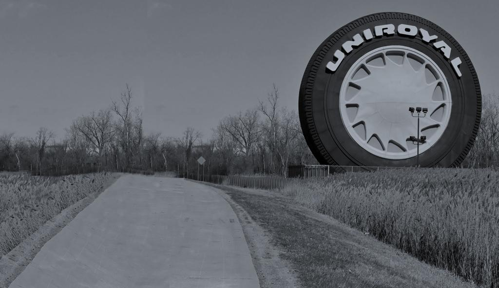 Uniroyal tire sign next to a road