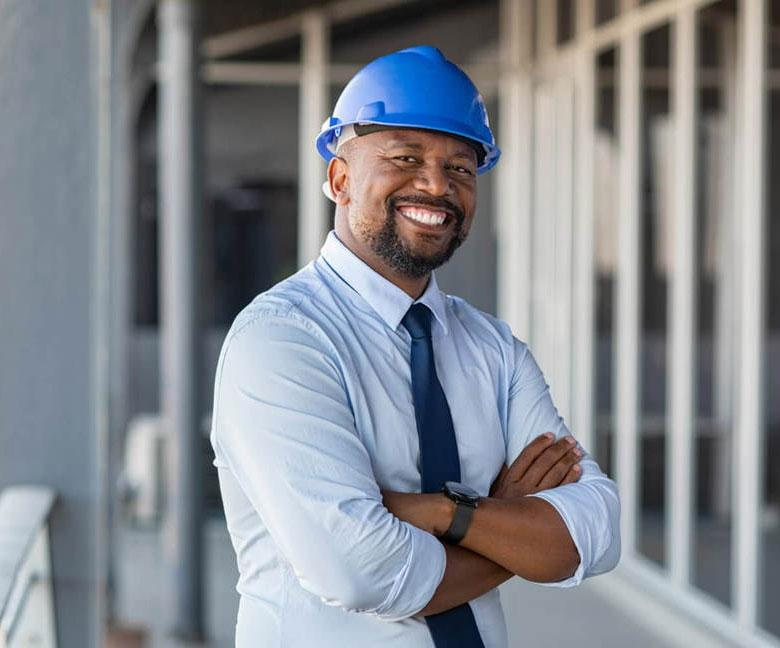 Man in blue hard hat and tie