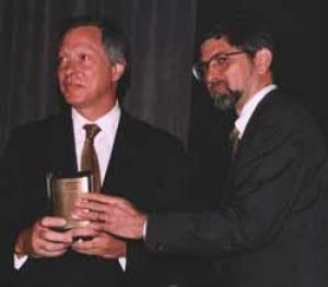 Donald J. Gogel (left), Chief Executive Officer of Clayton, Dubilier & Rice, receives the Private Equity Hall of Fame Award from Steven P. Galante, President of Asset Alternatives, Inc.